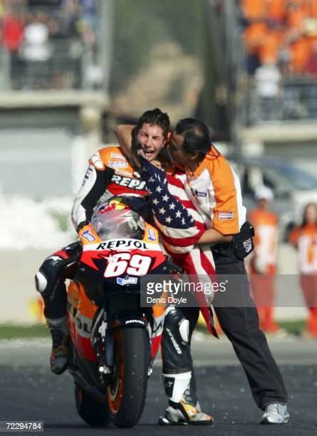 Nicky Hayden of the US reacts after clinching the World MotoGP title after finishing third in the MotoGP race at the Ricardo Torma racetrack on...