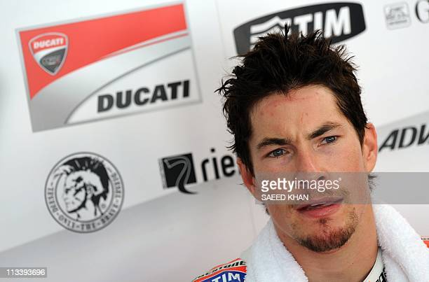 Nicky Hayden of the US waits at the Ducati pit during a MotoGP preseason second test run on the Sepang circuit near Kuala Lumpur on February 24 2011...