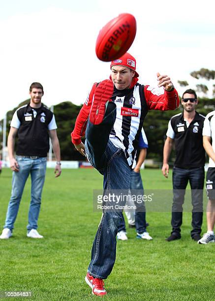Nicky Hayden of the USA and the Ducati Team tries his hand at Australian Rules Football as he prepares for the Australian MotoGP which is round 16 of...