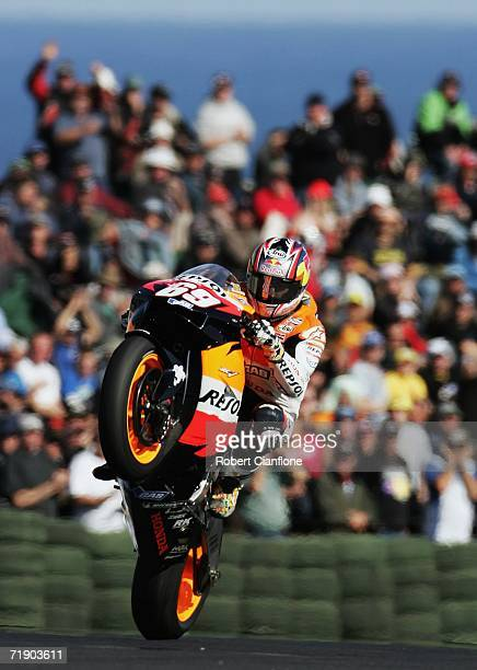 Nicky Hayden of the USA and the Repsol Honda Team celebrates in front of the fans after taking out pole position for tomorrows race after the...