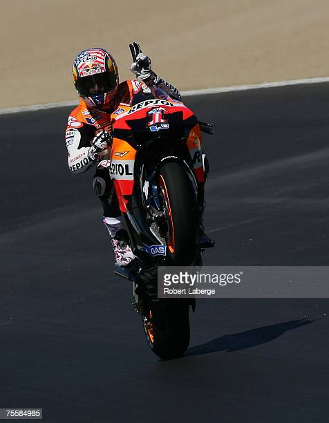 Nicky Hayden of the USA pops a wheelie on the Team Repsol Honda after practice for the 2007 Red Bull US Grand Prix part of the MotoGP World...