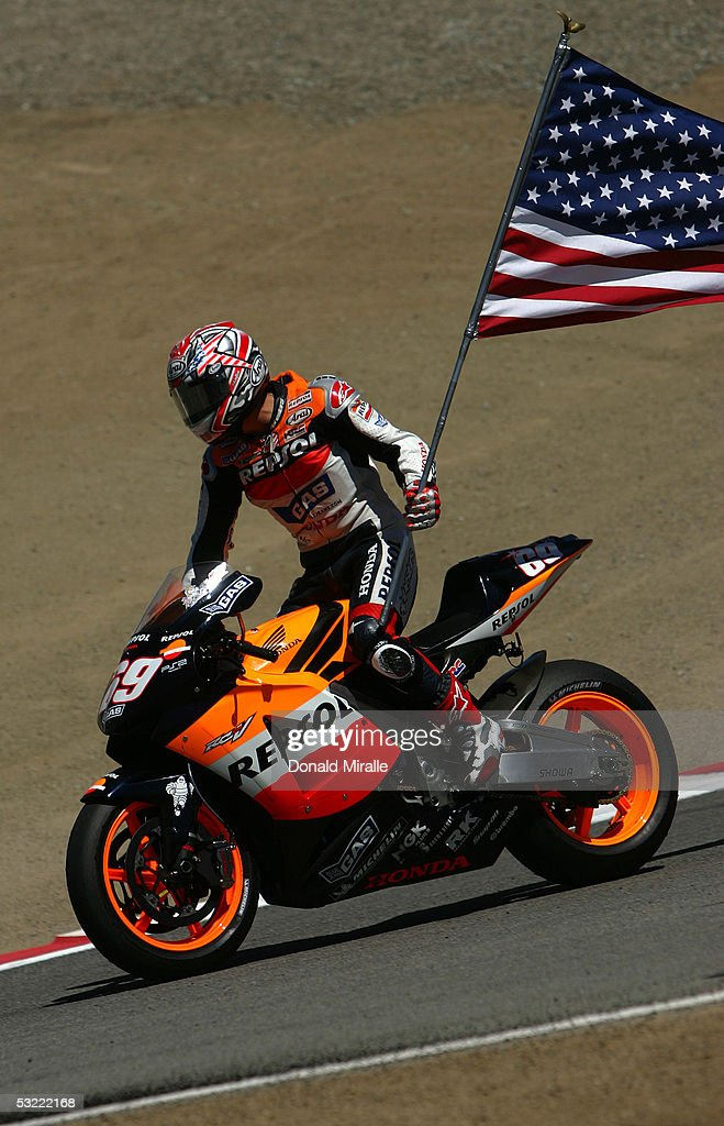 <a gi-track='captionPersonalityLinkClicked' href=/galleries/search?phrase=Nicky+Hayden&family=editorial&specificpeople=227346 ng-click='$event.stopPropagation()'>Nicky Hayden</a> of the USA rides his #69 Repsol Honda Team on a victory lap after winning the 2005 Red Bull U.S. Grand Prix, part of the MotoGP World Championships, at Mazda Raceway Laguna Seca on July 10, 2005 in Monterey, California.