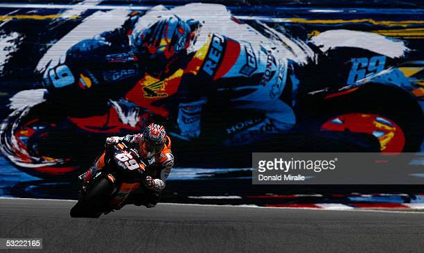 Nicky Hayden of the USA rides his Repsol Team Honda in front of his likeliness on a billboard during the final laps en route to winning the 2005 Red...