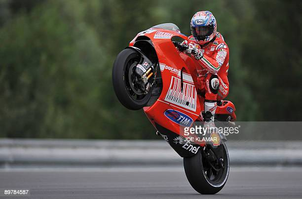 Nicky Hayden of US wheelies his motorbike as he finishes the first free practice at the Czech Republic Moto GP in Brno on August 142009 Spain's Jorge...