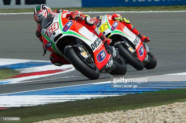 Nicky Hayden of USA and Ducati Marlboro Team leads Valentino Rossi of Italy and Ducati Marlboro Team during the free practice of MotoGp Of Holland at...