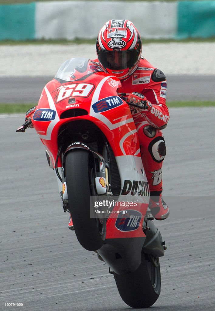 <a gi-track='captionPersonalityLinkClicked' href=/galleries/search?phrase=Nicky+Hayden+-+Motorcycle+Racer&family=editorial&specificpeople=227346 ng-click='$event.stopPropagation()'>Nicky Hayden</a> of USA and Ducati Marlboro Team lifts the front wheel during the MotoGP Tests in Sepang - Day Four at Sepang Circuit on February 6, 2013 in Kuala Lumpur, Malaysia.