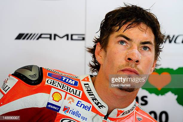 Nicky Hayden of USA and Ducati Team looks on at his pit during the qualifying at Circuit de Catalunya on June 2 2012 in Montmelo Spain Casey Stoner...