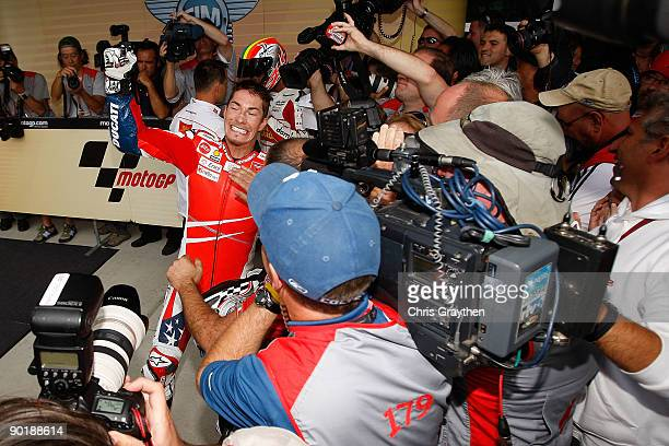 Nicky Hayden rider of the Ducati Team celebrates after his 3rd place podium finish after the MotoGP Red Bull Indianapolis Grand Prix at the...