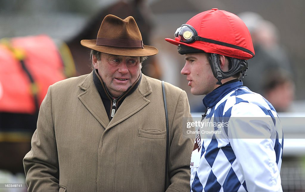 Nicky Henderson chats with jockey Jeremiah McGrath at Sandown Park racecourse on February 22, 2013 in Esher, England.