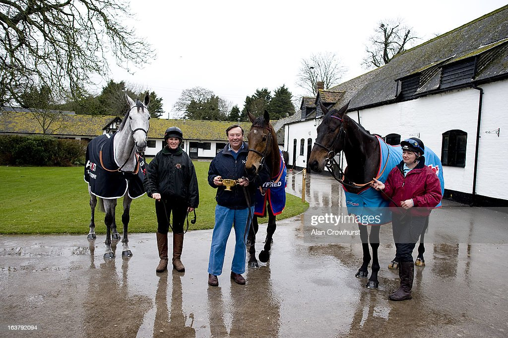 Nicky Henderson with Cheltenham Gold Cup winner Bobs Worth (C) and Simonsig (L) with Sprinter Sacre (R) at Seven Barrows Stables on March 16, 2013 in Lambourn, England.