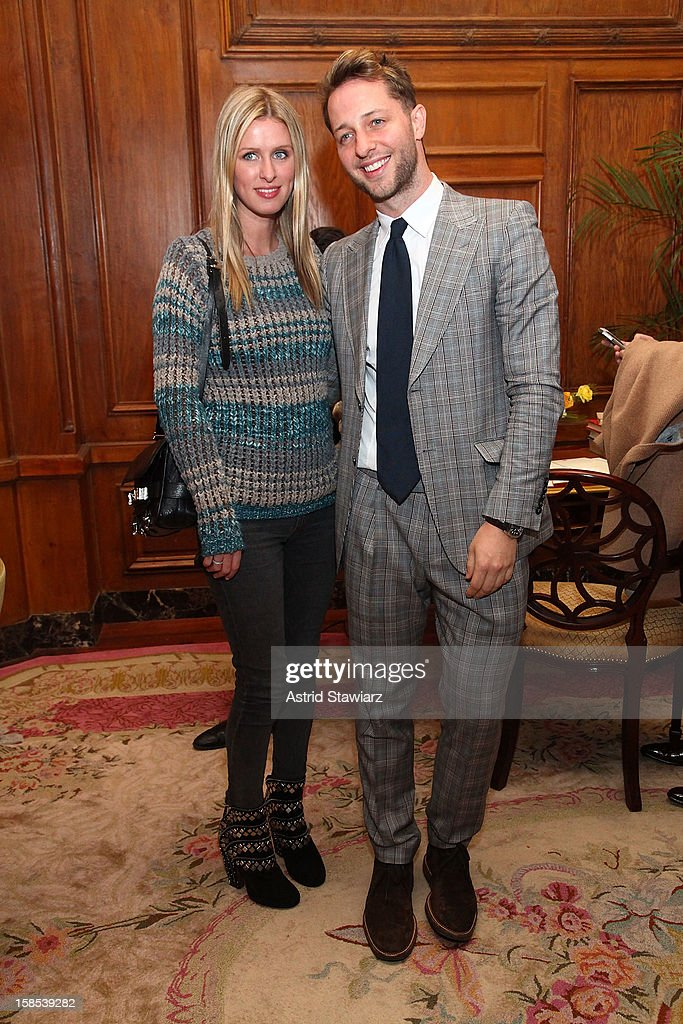 Nicky Hilton and Derek Blasberg pose for photos durng the Derek Blasberg For Opening Ceremony Stationery Launch Party at Saint Regis Hotel on December 18, 2012 in New York City.
