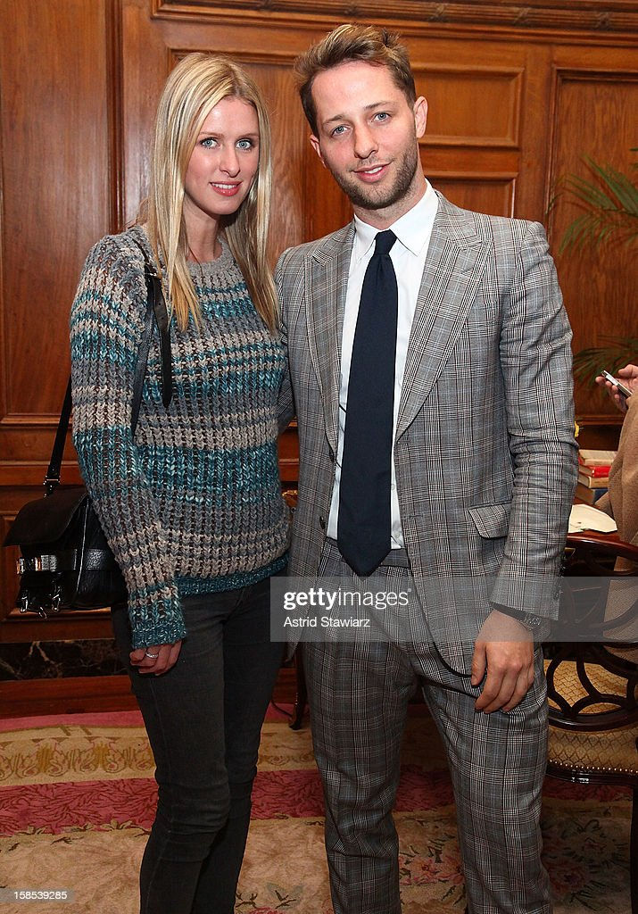 Nicky Hilton and <a gi-track='captionPersonalityLinkClicked' href=/galleries/search?phrase=Derek+Blasberg&family=editorial&specificpeople=856710 ng-click='$event.stopPropagation()'>Derek Blasberg</a> pose for photos durng the <a gi-track='captionPersonalityLinkClicked' href=/galleries/search?phrase=Derek+Blasberg&family=editorial&specificpeople=856710 ng-click='$event.stopPropagation()'>Derek Blasberg</a> For Opening Ceremony Stationery Launch Party at Saint Regis Hotel on December 18, 2012 in New York City.