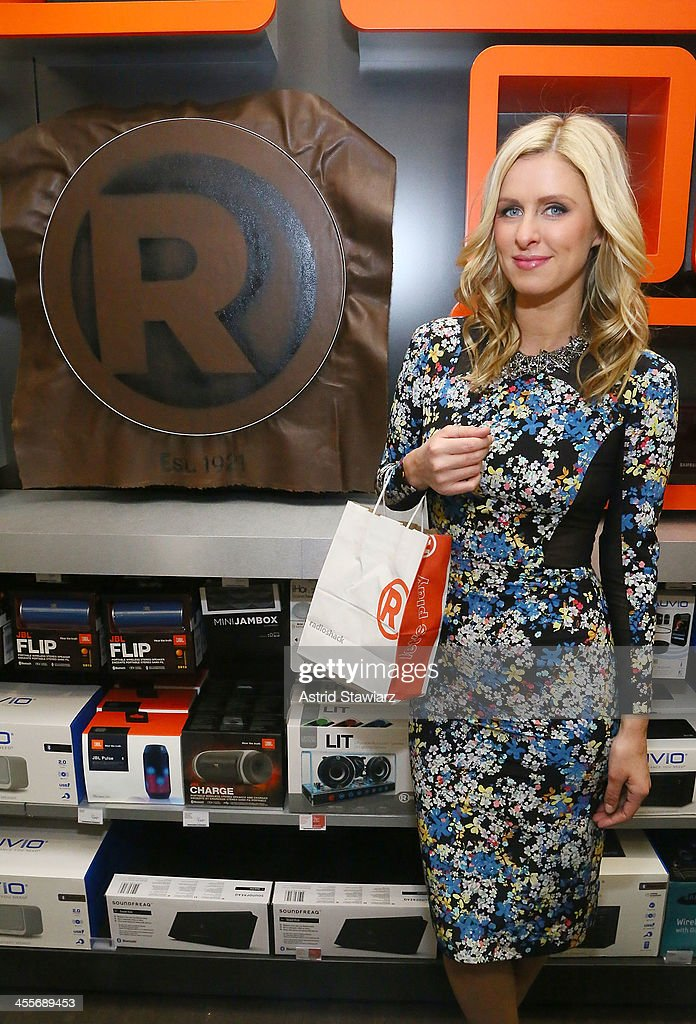 Nicky Hilton attends the Charlotte Ronson Holiday Party at RadioShack Pop-Up Store in Times Square on December 12, 2013 in New York City.