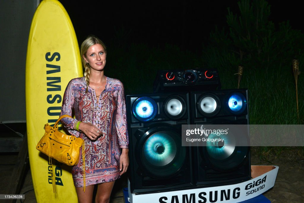 Nicky Hilton sizes up the brand new sound system from Samsung at their #GigaSoundBlast Summer DJ series at Surf Lodge on July 13, 2013 in Montauk, New York.