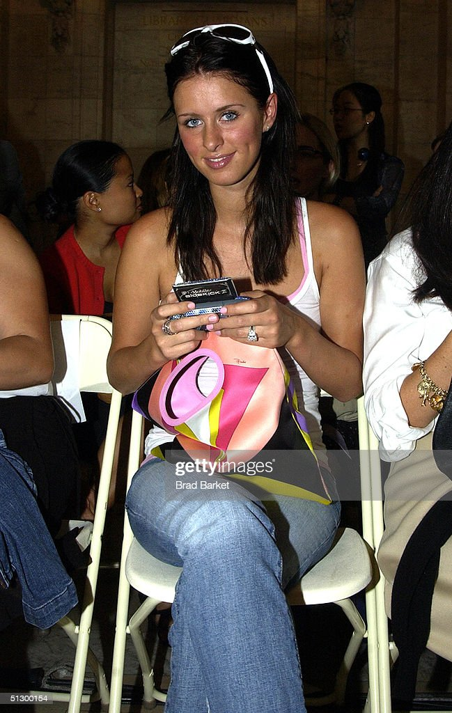 Nicky Hilton uses her twoway pager at the Jill Stuart show during Olympus Fashion Week Spring 2005 at the New York Public Library September 13 2004...
