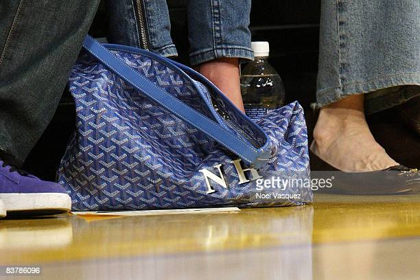 Nicky Hilton's bag at her feet while attending the Los Angeles Lakers vs Denver Nuggets game at the Staples Center on November 21 2008 in Los Angeles...