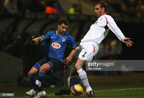 Nicky Hunt of Bolton Wanderers battles for the ball with Simao Fonseca of Atletico Madrid during the UEFA Cup Round of 32 First Leg match between...