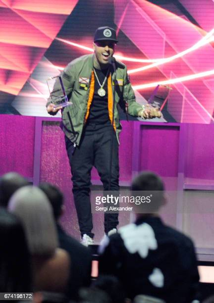 Nicky Jam accepts an award onstage at the Billboard Latin Music Awards at Watsco Center on April 27 2017 in Coral Gables Florida
