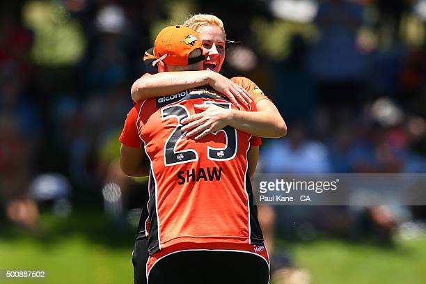 Nicky Shaw and Katherine Brunt of the Scorchers celebrate the wicket of Kate Cross of the Heat during the Women's Big Bash League match between the...