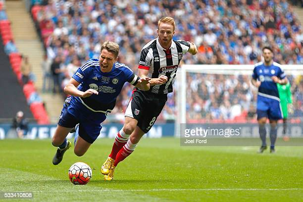 Nicky Wroe of FC Halifax Town is fouled by Craig Disley of Grimsby Town during the FA Trophy Final match between Grimsby Town FC v FC Halifax Town at...