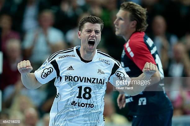 Niclas Ekberg of Kiel celebrate during the DKB HBL Bundesliga match between THW Kiel and SG FlensburgHandewitt on August 26 2014 in Kiel Germany