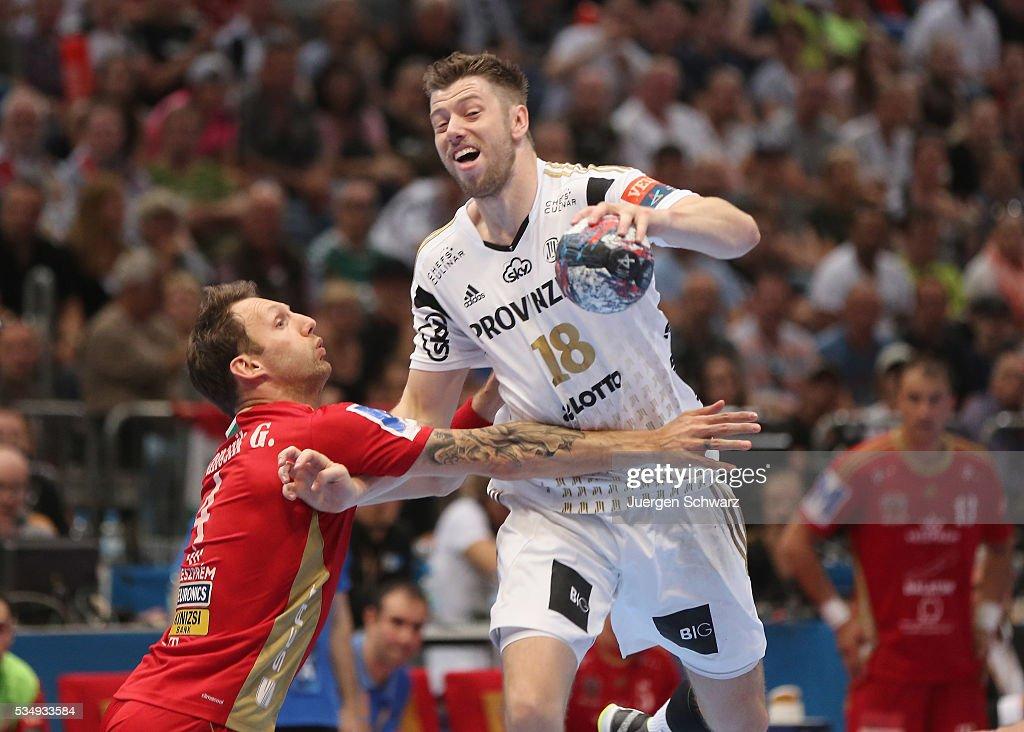 Niclas Ekberg of Kiel (R) is blocked during the second semi-final of the EHF Final4 between THW Kiel and MVM Veszprem on May 28, 2016 in Cologne, Germany.