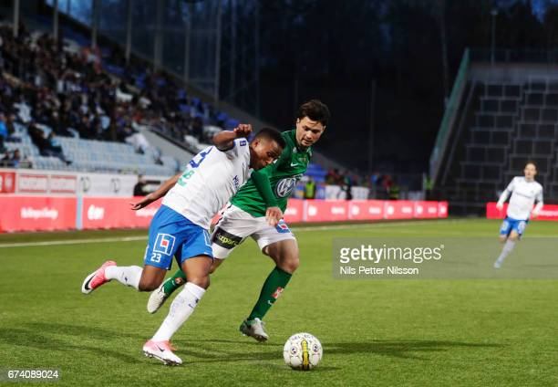 Niclas Eliasson of IFK Norrkoping and Jonathan Tamimi of Jonkopings Sodra IF competes for the ball during the Allsvenskan match between IFK...