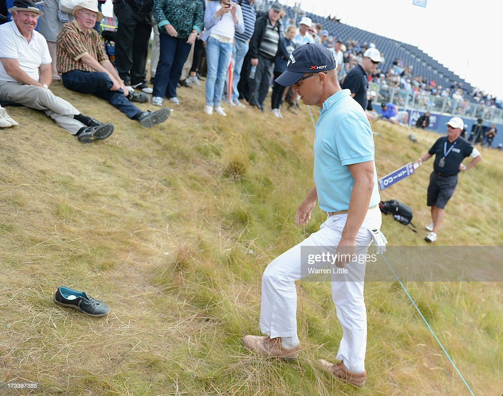 <a gi-track='captionPersonalityLinkClicked' href=/galleries/search?phrase=Niclas+Fasth&family=editorial&specificpeople=211223 ng-click='$event.stopPropagation()'>Niclas Fasth</a> of Sweden checks the lie of his ball which landed in a Woman's shoe on the 18th hole during the third round of the Aberdeen Asset Management Scottish Open at Castle Stuart Golf Links on July 13, 2013 in Inverness, Scotland.