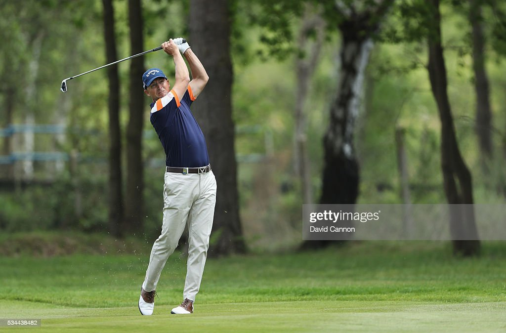 <a gi-track='captionPersonalityLinkClicked' href=/galleries/search?phrase=Niclas+Fasth&family=editorial&specificpeople=211223 ng-click='$event.stopPropagation()'>Niclas Fasth</a> of Sweden hits his 2nd shot on the 9th hole during day one of the BMW PGA Championship at Wentworth on May 26, 2016 in Virginia Water, England.