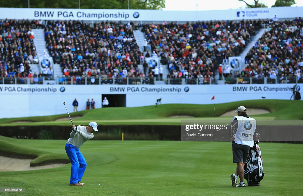 <a gi-track='captionPersonalityLinkClicked' href=/galleries/search?phrase=Niclas+Fasth&family=editorial&specificpeople=211223 ng-click='$event.stopPropagation()'>Niclas Fasth</a> of Sweden hits his 3rd shot on the 18th hole during the third round of the BMW PGA Championship on the West Course at Wentworth on May 25, 2013 in Virginia Water, England.