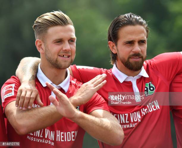 Niclas Fuellkrug and Martin Harnik of Hannover 96 gesture during the team presentation at on July 14 2017 in Hanover Germany