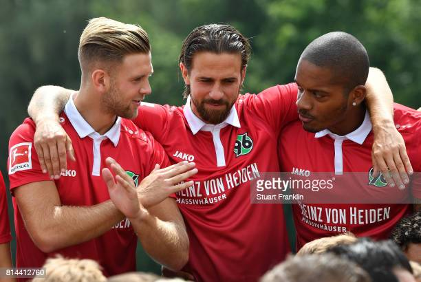 Niclas Fuellkrug Martin Harnik and Charlison Bebschop of Hannover 96 gesture during the team presentation at on July 14 2017 in Hanover Germany