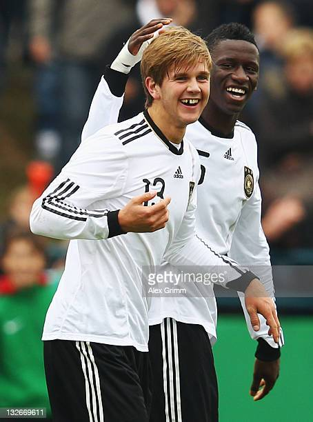 Niclas Fuellkrug of Germany celebrates his team's second goal with team mate Antonio Ruediger during the U19 International friendly match between...