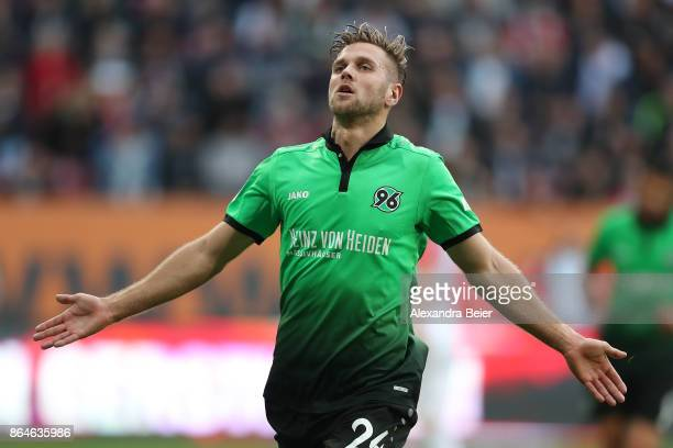 Niclas Fuellkrug of Hannover celebrates after he scored the winning goal for Hannover to make it 12 during the Bundesliga match between FC Augsburg...