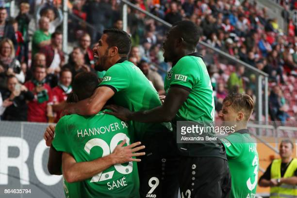Niclas Fuellkrug of Hannover celebrates with team mates after he scored the winning goal for Hannover to make it 12 during the Bundesliga match...