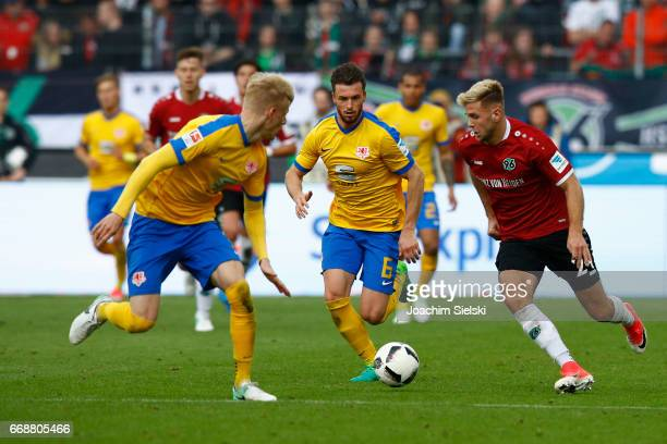 Niclas Fuellkrug of Hannover challenges Saulo Decarli and Quirin Moll of Braunschweig during the Second Bundesliga match between Hannover 96 and...