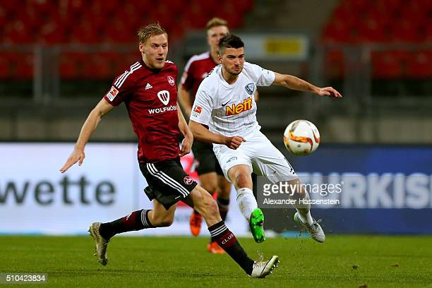 Niclas Fuellkrug of Nuernberg battles for the ball with Marco Terrazzino of Bochum during the Second Bundesliga match between 1 FC Nuernberg and VfL...