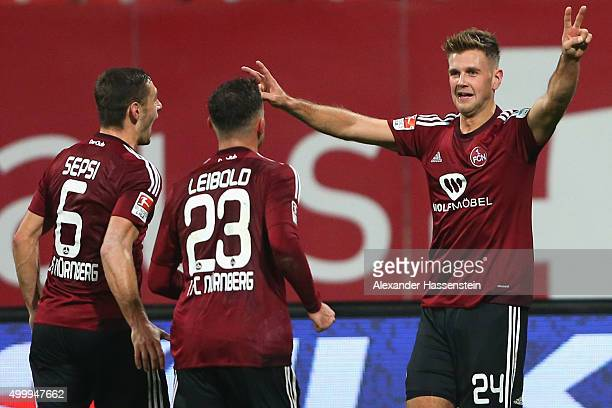 Niclas Fuellkrug of Nuernberg celebrates scoring the opening goal during the Second Bundesliga match between 1 FC Nuernberg and SC Paderborn 07 at...