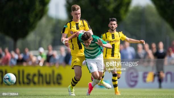 Niclas Knoop of Dortmund attacks Leon Sitz of Bremen during the B Juniors German Championship Semi Final match between Borussia Dortmund and Werder...