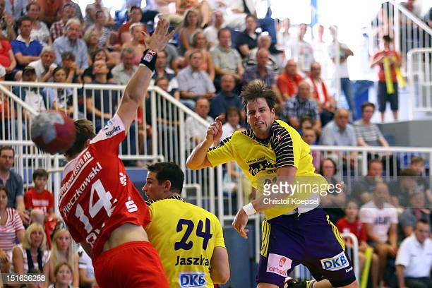 Niclas Pieczkowski of Essen blocks a shot of Markus Bult of Berlin during the DKB Handball Bundesliga match between TUSEM Essen and Fueches Berlin at...