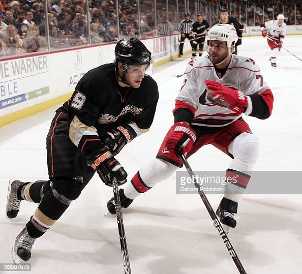 Niclas Wallin of the Carolina Hurricanes defends against Bobby Ryan of the Anaheim Ducks during the game on November 25 2009 at Honda Center in...