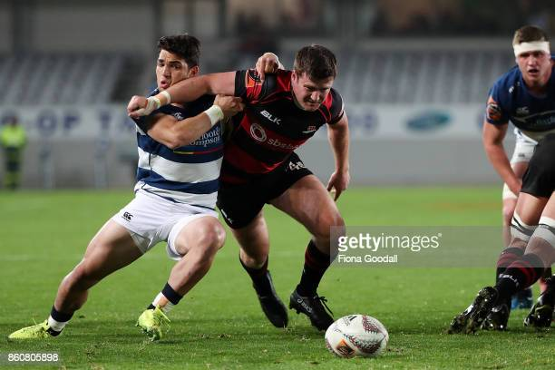 Nico Costa of Auckland and Brett Cameron of Canterbury chase the ball during the round nine Mitre 10 Cup match between Auckland and Canterbury at...