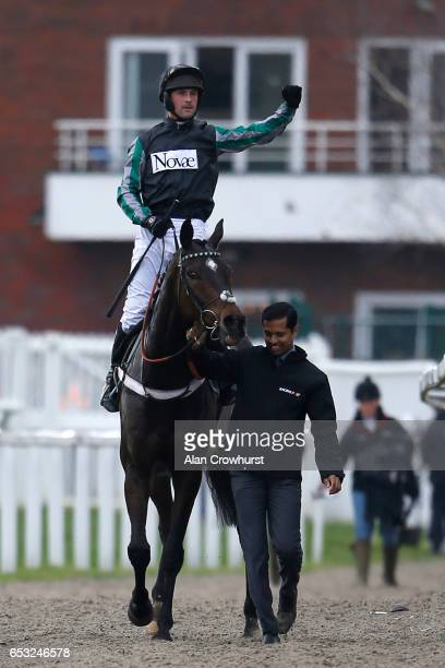 Nico de Boinville celebrates after riding Altior to win The Racing Post Arkle Challenge Trophy Novices' Steeple Chase at Cheltenham racecourse on day...
