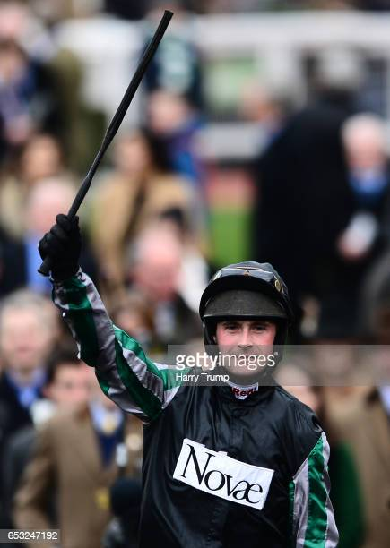 Nico De Boinville celebrates after winning on Altior in the Racing Post Arkle Challenge Trophy Novices Chase during Champion Day of the Cheltenham...