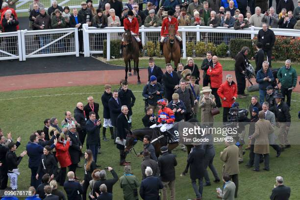Nico de Boinville celebrates after winning the Betway Queen Mother Champion Chase with Sprinter Sacre during Ladies Day at the 2016 Cheltenham...