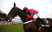 Nico de Boinville celebrates on board Sprinter Sacre after winning the Betway Queen Mother Champion Chase on Ladies Day of the Cheltenham Festival at...