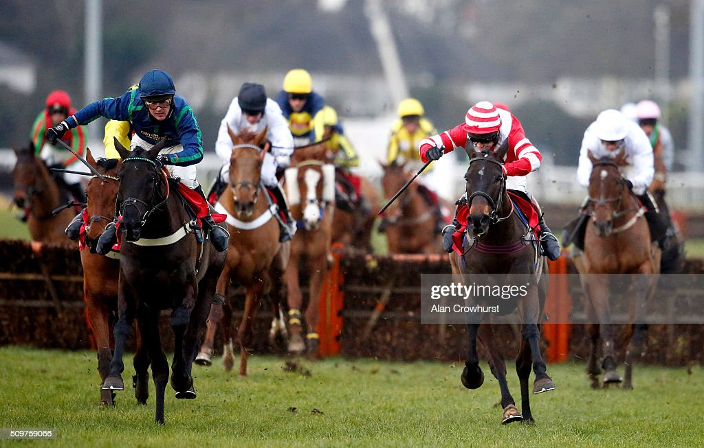 Nico de Boinville riding Ballyhenry (L, blue) clear the last to win The racinguk.com/winterseasonticket Novices' Hurdle Race at Kempton Park racecourse on February 12, 2016 in Sunbury, England.
