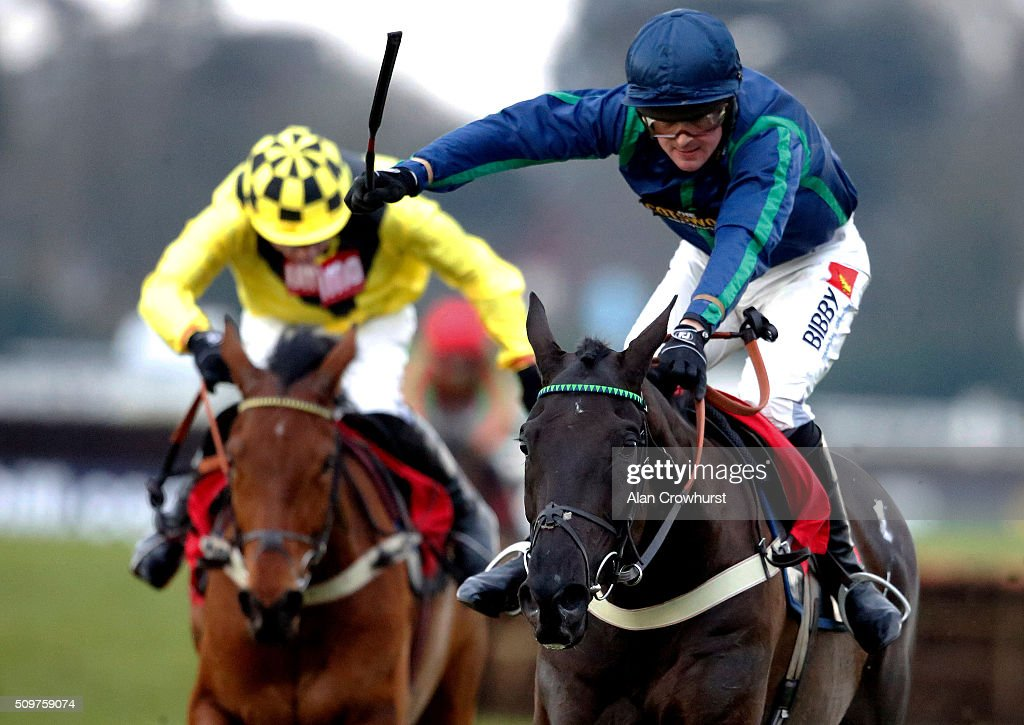 Nico de Boinville riding Ballyhenry (R) clear the last to win The racinguk.com/winterseasonticket Novices' Hurdle Race at Kempton Park racecourse on February 12, 2016 in Sunbury, England.