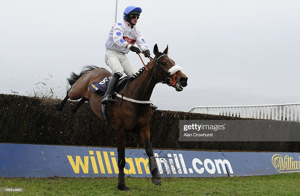 Nico de Boinville riding Brackloon High claer the last to win the William Hill - Download The App Handicap Steeple Chase at Kempton racecourse on January 12, 2013 in Sunbury, England.