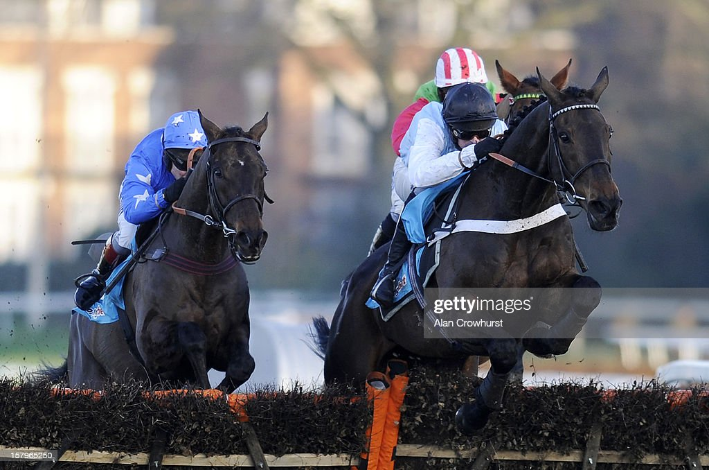 Nico de Boinville riding Petit Robin (R) clear the last to win The Sportingbet Handicap Hurdle at Sandown racecourse on December 08, 2012 in Esher, England.